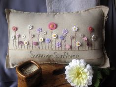 This flower-themed hand-made muslin needlework pillow is perfect for summer decor and fans of flowers and the sun! Size is approximately 15 x 10.