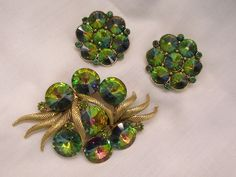 Always something exciting in store many items on sale from 10 to 60% offGorgeous Rivoli watermelon Rhinestone Brooch Earring Set Purples greens pinks