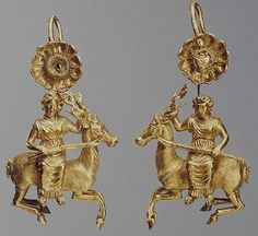 Pair of Earrings with a Rosette and.Rosette and Artemis Riding on a deer Gold and enamel; cast, stamped, decorated with filigree.  325-300 bc, Nymphaeum Necropolis, Crimea, environs of Kerch- now in the Hermitage museum…..