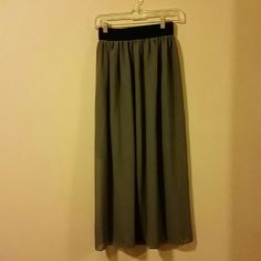 Gray lightweight flowy maxi skirt Slightly see through, darker slip is attached underneath. Very stretchy and tight black band on top. Fits like a small. Never worn. Skirts Maxi