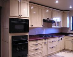 Tuscan Kitchen White Cabinets ~~~Almost looks like they put blue lighting under the cabinets!