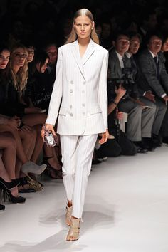 Double-breasted pantsuit from Salvatore Ferragamo:  classic and worth the investment.  The cut of the blazer draws the eye to the neckline and falls just below the hip-- perfect for a pear-shaped figure by balancing top and bottom.  Desk to dinner:  Add statement necklace, bright cami, and strappy sandals.    Dress for Success • Salvatore Ferragamo #Womens #business #fashion