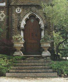 Victorian Literature: A Victorian House  gothic wooden front door urns gardens front steps