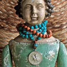 very old and fine sterling joan of arc religious medallion on beautiful authentic fluted turquoise beads...
