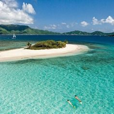 Snorkeling at Sandy Cay in the British Virgin Islands on a sailboat charter