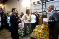 First Lady Michelle Obama volunteers for Feeding America with congressional spouses at the Capitol City Food Bank in northeast Washington, D.C., April 29, 2009.