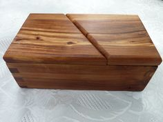 For anyone who loves apples: here is a box made of apple wood from a local apple tree.  Handcrafted Jewelry/ Keepsake Box in Apple Wood by Geneswoodnstuff, $42.00