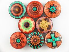 Set of 8 Cairo mandala print wood drawer knobs. Photo 1 is Set 1 Photo 2 is Set 2 These wood knobs are 1.5 wide and have been stained English Chestnut with a decoupage mandala pattern. These knobs are made with high quality digital images that are decoupaged onto the wood knob and
