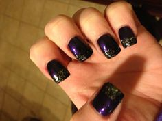 My dark purple and sparkly black French tip nails
