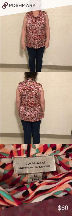 Tahari mock sleeveless turtleneck blouse Lightly worn Tahari mock sleeveless turtleneck medium Tahari Tops Blouses