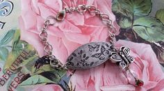 Check out this item in my Etsy shop https://www.etsy.com/listing/226549577/butterflies-pewter-metal-plate-bracelet