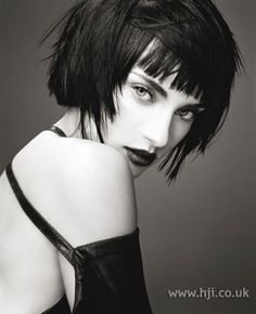 """""""Short black hair was cut into a blunt bob with overhanging sections through the sides and straightened Hairstyle by: Robert Cromeans for Paul Mitchell Location: America"""""""