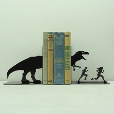 T-Rex Attack Metal Art Bookends - It's too late for Christmas and too early for my birthday,  but just realize this is the perfect gift for me.