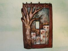 City Buildings with Tree Cityscape nature Light Switch Cover Organic vs. Mechanic Polymer Clay  Lightswitch Plate Metallic. $22.00, via Etsy.