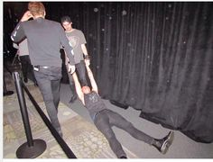 Michael dragging Ashton on floor after concert