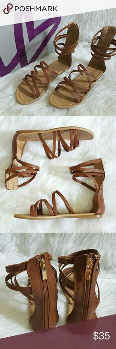 """Strappy Gladiator Sandals Lane Bryant. Size 10W. Color- Tannin' (Brown) Faux Leather. """"Your go-to shoe for the sunny days ahead, our strappy gladiator sandal is a versatile pick with style cred to spare. Designed for comfort in wide widths with elastic stretch in each strap for a secure fit that won't pinch. Zip-up back."""" Brand new in box. Lane Bryant Shoes Sandals"""