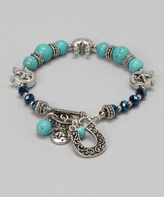Classic country style adorns this sophisticated piece. Featuring a mix of turquoise and western-inspired charms, this bracelet is any gal's jewelry dream come true.