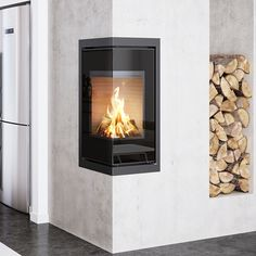 Rais Q-BE: An elegant insert which rounds off a corner in the most beautiful of ways and is equipped with a single-piece glass door. #kernowfires #wadebridge #redruth #cornwall #rais #fire #stove #wood #burner #glass #door #modern #contemporary #inset #log #store #corner #design