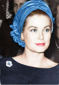 Princess Grace of Monaco, wearing a platinum, diamond and sapphire pin.