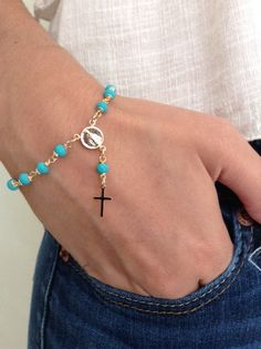 Delicate 4mm turquoise faceted crystals and gold filled wire are connected by hand to form this gorgeous rosary style bracelet. Lobster gold plated clasp for closure in to make it easy to put it on by