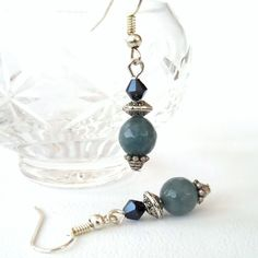 Handmade earrings, with faceted blue aquamarine & jet crystal £6.00