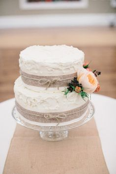 Cake love: a simple wedding cake decorated with hessian, twine and seasonal blooms