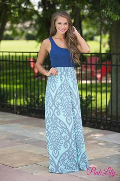 Conquer the fashion world in our gorgeous damask maxi dresses! Featuring a navy bodice paired with a grey and mint skirt in damask print, this dress will be a knockout at any formal or informal function!