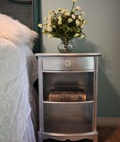 Turn boring furniture GLAM with chrome spray paint and glass knob! I started re-doing our night stands last year. I originally bought a metallic silver Martha Stewart paint color but the finish is not metallic. Could be the roller I used?? I think I might use this as my plan B!! It's the look I meant to get but didn't...