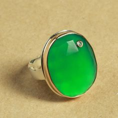 Large faceted green onyx ring from Jamie Joseph Jewelry with small diamond inset