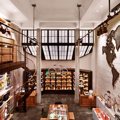 Shinola - Love the stairs and the shelves, and the map and the windows. Very cool space.