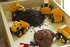 coffee beans, chocolate playdough, and diggers