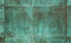 Maybe some of the original buildings had oxidised copper panels (see pic), and the later buildings just used paint to try and copy them to get the same effect? Description from skyscrapercity.com. I searched for this on bing.com/images