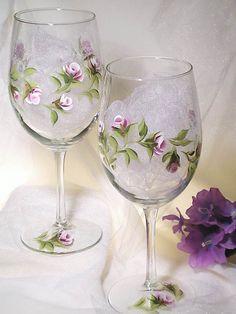 Glassware - Hand Painted Wine Glasses, Amethyst Lavender Rose Buds, White Edges, Fresh Green Leaves Set of 4, Summer Hostess Gift. $42.00, via Etsy.