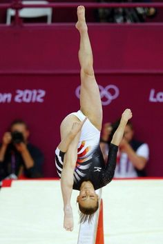 Rie Tanaka of Japan competes in the balance beam during the women's gymnastics qualification in the North Greenwich Arena during the London 2012 Olympic Games July resolution: 2944 x Gymnastics Posters, Gymnastics Photography, Gymnastics Pictures, Sport Gymnastics, Olympic Gymnastics, Rhythmic Gymnastics Leotards, Olympic Games, Amazing Gymnastics, Artistic Gymnastics