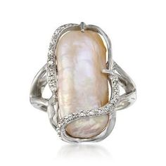 Sterling silver with diamonds and a pink baroque pearl--WANT.
