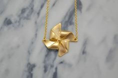 SALE  Gold Origami Necklace  Pinwheel Charm Pendant  by Discoluxe