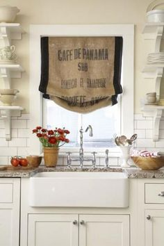 Skip the boring store-bought kitchen curtains and turn a vintage burlap potato or coffee sack into a Roman window shade! | 16 farm kitchen features we love | Living the Country Life | http://www.livingthecountrylife.com/homes-acreages/country-homes/16-farm-kitchen-features-we-love/