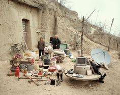"""""""Jiadang,"""" or """"Family Stuff"""" is a photo series by Chinese photographer Huang Qingjun, that shows portraits of Chinese families with all their stuff. The photographer has spent nearly a decade traveling around China. Family Posing, Family Portraits, Family Photos, Fotojournalismus, Living Environment, Rural Area, Photo Series, Art Series, China Travel"""