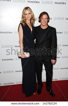 Image from http://image.shutterstock.com/display_pic_with_logo/842245/141782134/stock-photo-toby-stephens-and-wife-anna-louise-plowman-arriving-for-the-glamour-women-of-the-year-awards-141782134.jpg.