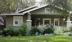 Bungalow House Pictures: California Bungalow:  With thick, square columns and a sloping roof, this stucco-sided home is a classic California Bungalow.    California is home to the American Bungalow style, and the bungalows that evolved there have become iconic across the USA.