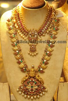 Two tone uniquely crafted kundan work ruby necklace with gold balls embellished at the top and bottom with south pearls combination, attr...