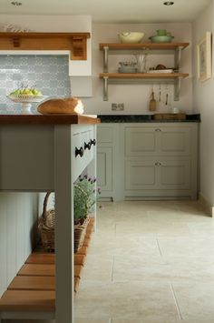 Grey green kitchen - love the colour of the cabinets but may be better on the walls