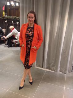 In the orange floral co-ord and orange Katy car coat! Nice and bright for spring x