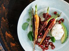 Baked carrot with pomegranate bbq sauce, avocado and yoghurt