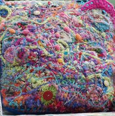 Scumbled crochet and knitting, made from little patches then crocheted over and around in unusual yarns, ribbons and bobbly yarn woven in at the end.