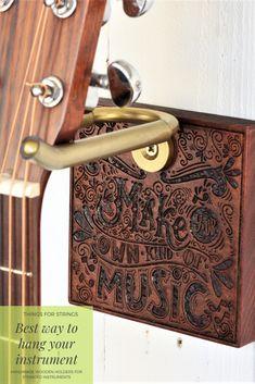 Beautiful handmade wooden holders to display and store your stringed instruments. Made in Ireland this mandala design wall mount is the perfect gift idea for any musician. #wallhook #wallmount #guitarholder #guitar #music #storage #giftidea #mom #mothersday #gold #wood #mandala #hanger #wallart #Guitarhanger #Guitarmount #Guitarhook #guitarstand #Giftsformusicians #instrumentdisplay #ukulele #ukelele #handpaintedukulele #customise Ukulele Wall Mount, Guitar Wall Hanger, Wall Hooks, Painted Ukulele, Office Music, Guitar Stand, Gold Wood, Mandala Design, Handmade Wooden