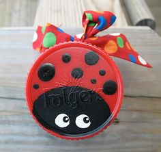 Recycled Ladybug Jar. I want to make a trail of these (minus the container of course), to hang in my kitchen.