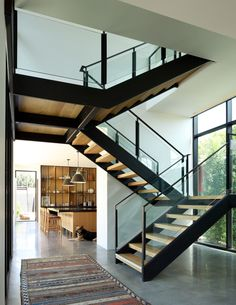 Modern home with Staircase, Metal Railing, and Wood Tread. Photo 3 of Scandinavian Modern Residence Open Staircase, Staircase Metal, Stairs, Staircase Design Modern, Modern Design, Dream Mansion, Metal Railings, Polished Concrete, Scandinavian Modern