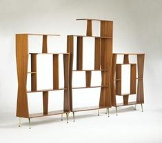 room divider / book case. I love the shapes within shapes, and how it plays with positive and negative space... and the irregular sides. Very sculptural.