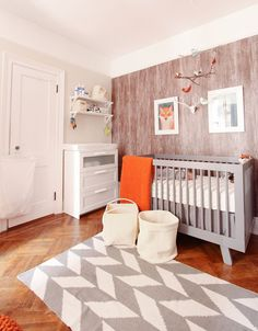 """Wood"" removable wallpaper contact paper used in baby boy's woodland-inspired nursery."
